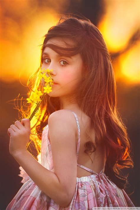 cute girl smelling  flower  hd desktop wallpaper