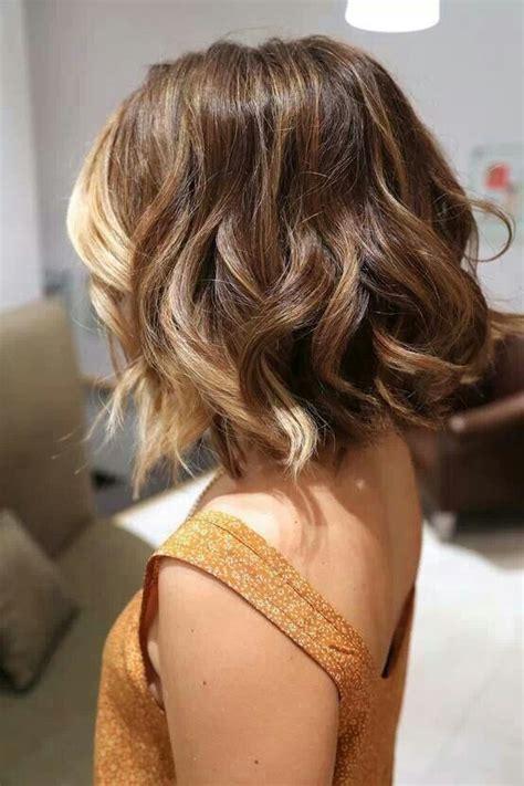 popular medium curly wavy hair styles  women