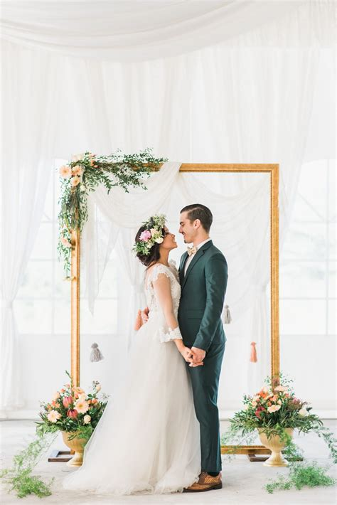 gold frame wedding backdrop accented  rustic flowers