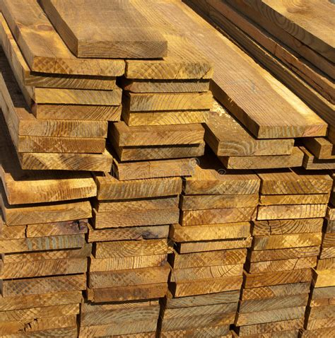 wood lumber planks  construction stock image image  pile green