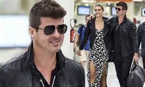 Robin Thicke and April Love Geary arrive for a romantic ...