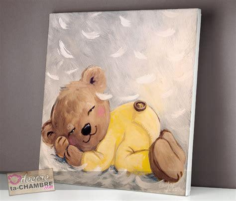 tableau ourson endormi sur des plumes vente tableau ourson doux pour enfants doudou nounours
