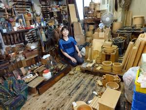 Azusa Miyahara sits in her woodworking and bath-building shop, Ito ...