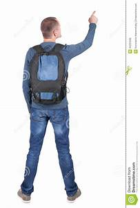 Back View Of Pointing Man With Backpack Looking Up  Stock