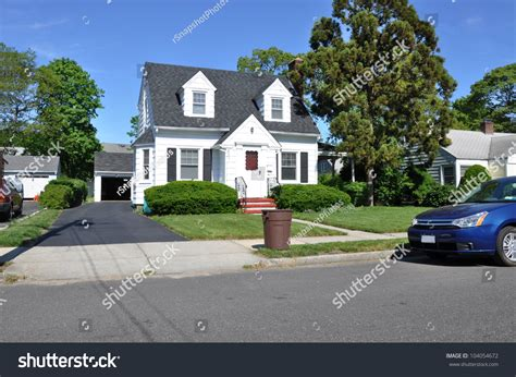 Trash Can Curbside Suburban Two Story Cape Cod House