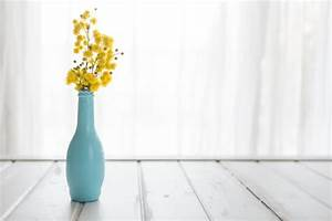 Decorative vase with yellow flowers Photo | Free Download