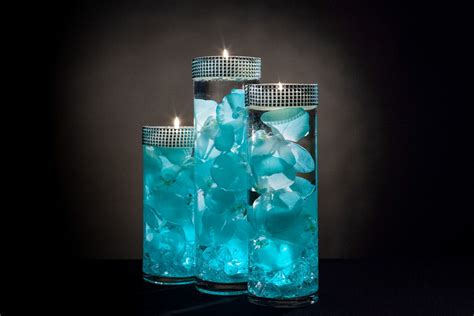 teal floral centerpieces  led lights  floating candles