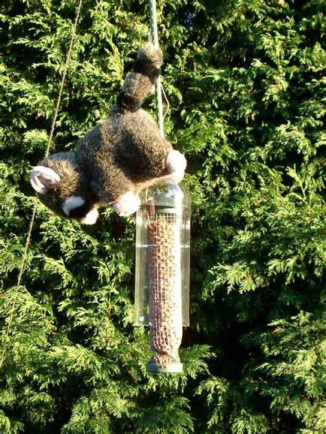 diy squirrel proof bird feeder lol this is genius also