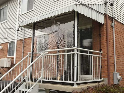 clear vinyl curtains protect porches driveways balconies  snow rain  wind