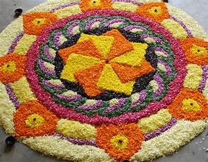 Worlds largest collection of pookalams flower carpet for Simple flower carpet designs