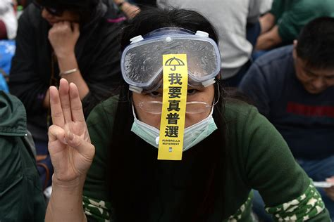 hong kong defiant protesters give hunger games  fingered salute  police clear camp