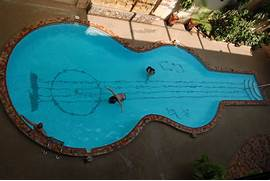Swimming Pool Design Shape Shape Of Guitar 6 E1292844044466 Stylish Guitar Shaped Swimming Pool