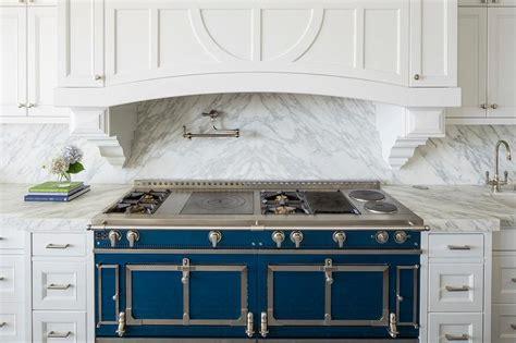 blue la cornue cornufe range  grey marble cooktop