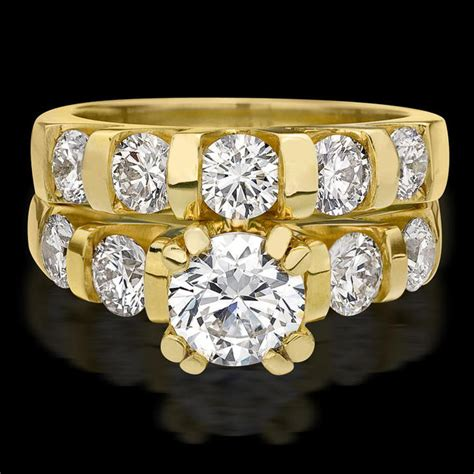 tension large diamond curved 8 prong engagement ring and matching wedding band bbr331