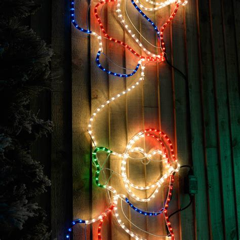 large animated climbing santa rope lights silhouette