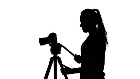 12238 photographer tripod silhouette videographer works with the tripod white silhouette