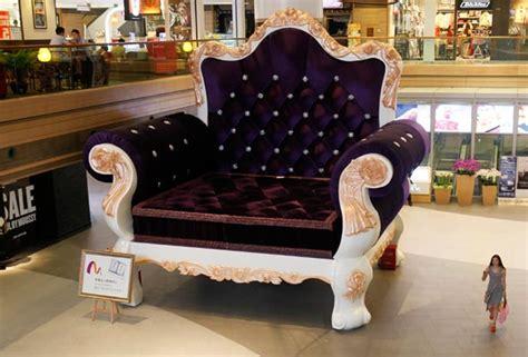 Giant Chair In Shanghai Dwarfs Shoppers|business