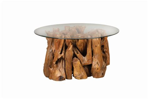 The top is hand cut, sanded, and polished to show smooth top and the sides are kept its nature if you are looking for a large one of kind coffee table for your living room, this almost 73 long cocktail table will do the job. Scott Living Rustic Teak Root Coffee Table