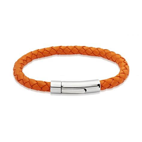 Unique & Co Orange Leather Bracelet  Mens From Goodwins. Koru Pendant. Zulu Watches. Sapphire Diamond Pendant. Gummy Rings. Unique Pendant. Male Anklet. 5 Diamond Band. Ogham Wedding Rings