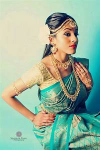 A south Indian bride in a sky blue and gold silk sari ...