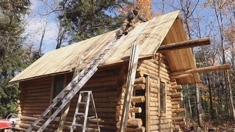 canadian man builds impressive log cabin