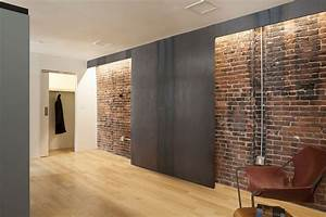 Exposed brick wall inside the modern home decoist