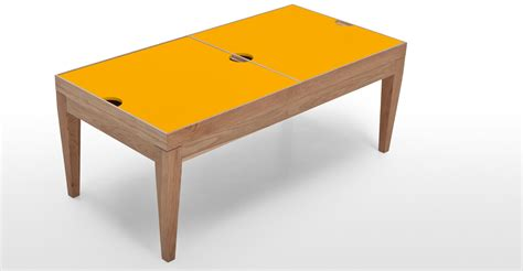 The painted finish allows for easy cleaning and. Dorig Storage Coffee Table in oak and yellow   made.com