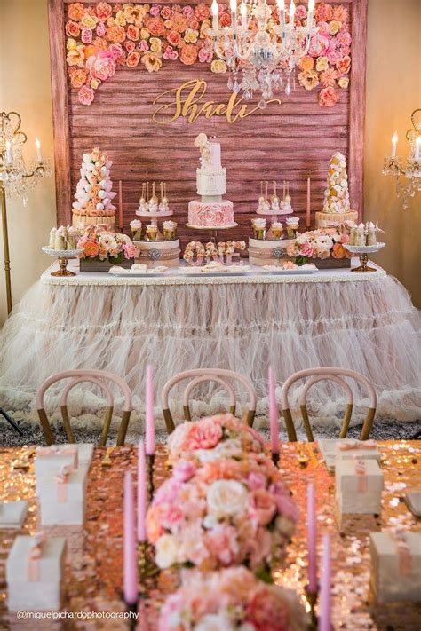 party setup dessert table from a pink gold 1st