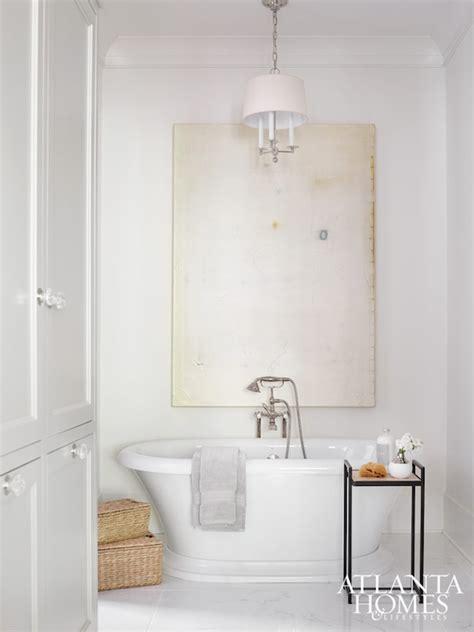 chandelier  bathtub transitional bathroom
