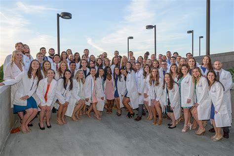 graduating dpt students receive  white coats