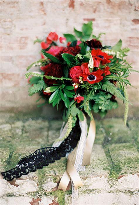 red bridal bouquet  garden roses anemones berries