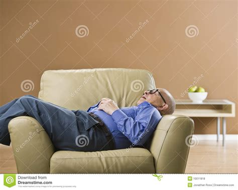 senior sleeping on chair royalty free stock photos