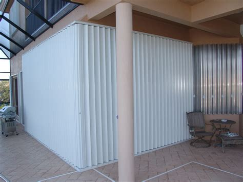 motorized accordion hurricane shutters high velocity category  hurricane protection
