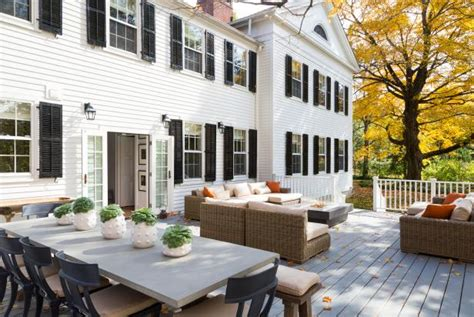 white colonial home  large  deck hgtv