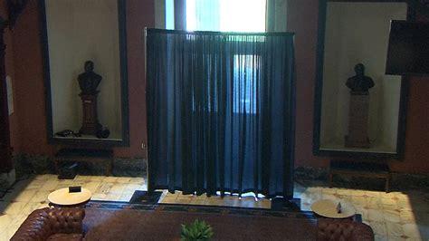 curtain blocks sight of confederate flag at state senator