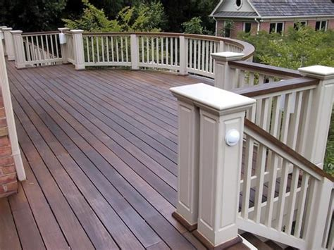 wood deck and railing top and white rails and posts