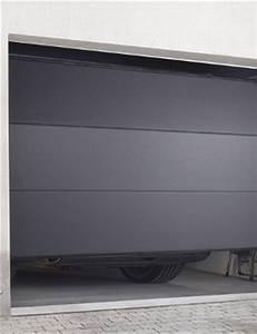 Porte de garage sur mesure porte de garage motorisee for Porte garage sectionnelle sur mesure