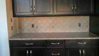 white subway tile backsplash with dark cabinets home