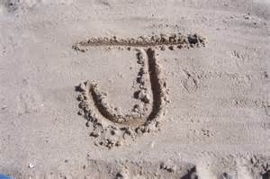 The Letter J Drawn in Sand