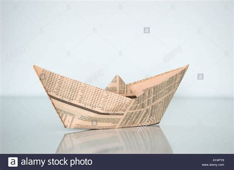 Paper Boat Made From Financial Newspaper On White Background Stock Photo, Royalty Free Image