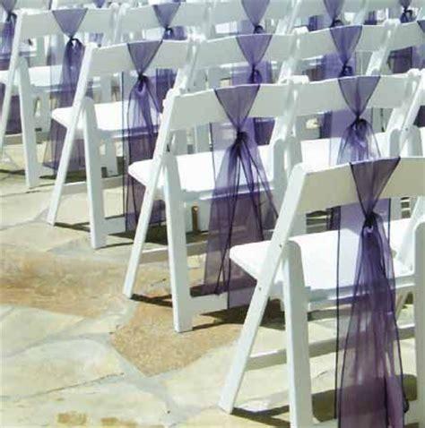 white resin chairs with purple sash purple wedding