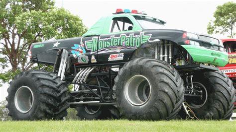 racing monster trucks monster truck racing hd wallpaper