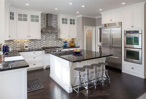 white kitchen cabinets with black island 37 gorgeous kitchen islands with breakfast bars pictures