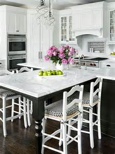white kitchen islands with seating extended seating the island and the black white checks are in this kitchen