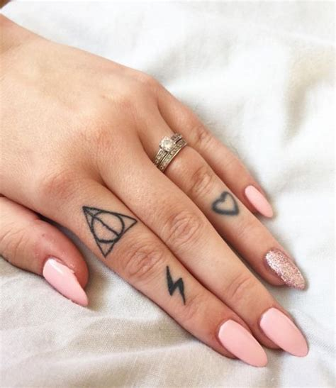deathly hallows  hearts tattoo ring