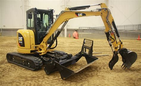 cats  mini excavator accepts skid steer attachments    enr