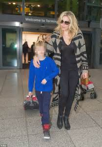 Hands on mum: Penny Lancaster looked happy to be walking ...