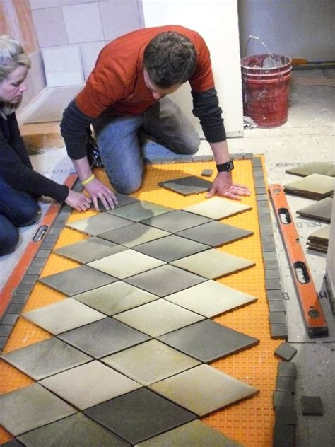 How To Lay A Tile Floor In A Bathroom by How To Create An Inlaid Tile Rug How Tos Diy