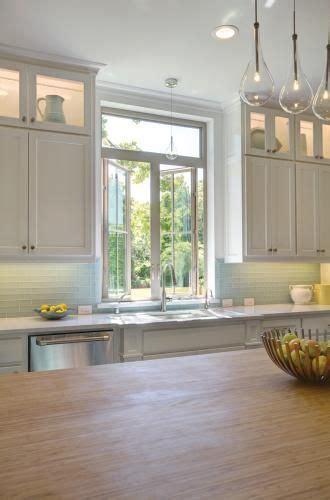 farmhouse kitchen    white casement windows   natural lighting