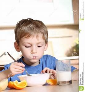 Child Eating Breakfast Stock Image - Image: 13744711